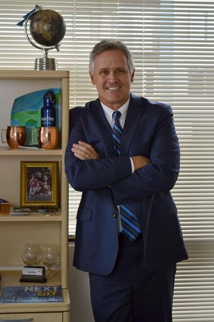 Harris Pezzella, President of Marathon Consulting in Virginia Beach standing in his office.